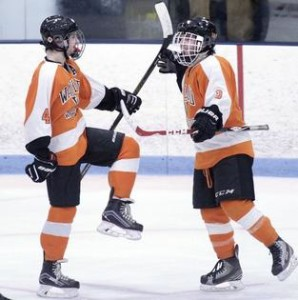 Image taken from MetroWest Daily News: Sr. Bobby Jones (left) celebrates a goal with So. Joe Lyons (Right)